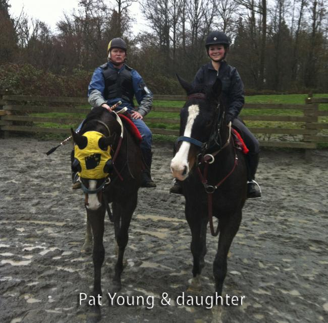Pat Young on race horse, along side his daughter